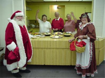 Santa and Mrs. Claus seem to approve of the party fare...
