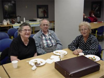 Coin club past president Earl Fritcher along with Dorsille Fritcher and Liselotte Koerner